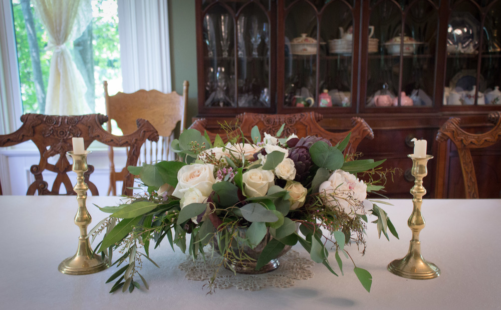 Food was served in the dining room, where this classic arrangement adorned the table.