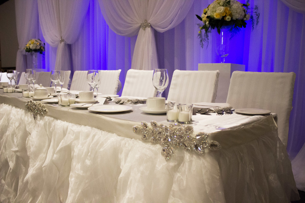 Inside at the reception. Draping and head table linen from Simply Beautiful decor.