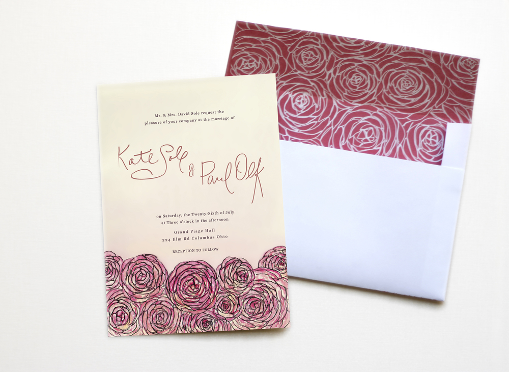 Pink ranunculus wedding invitation and custom matching envelope.