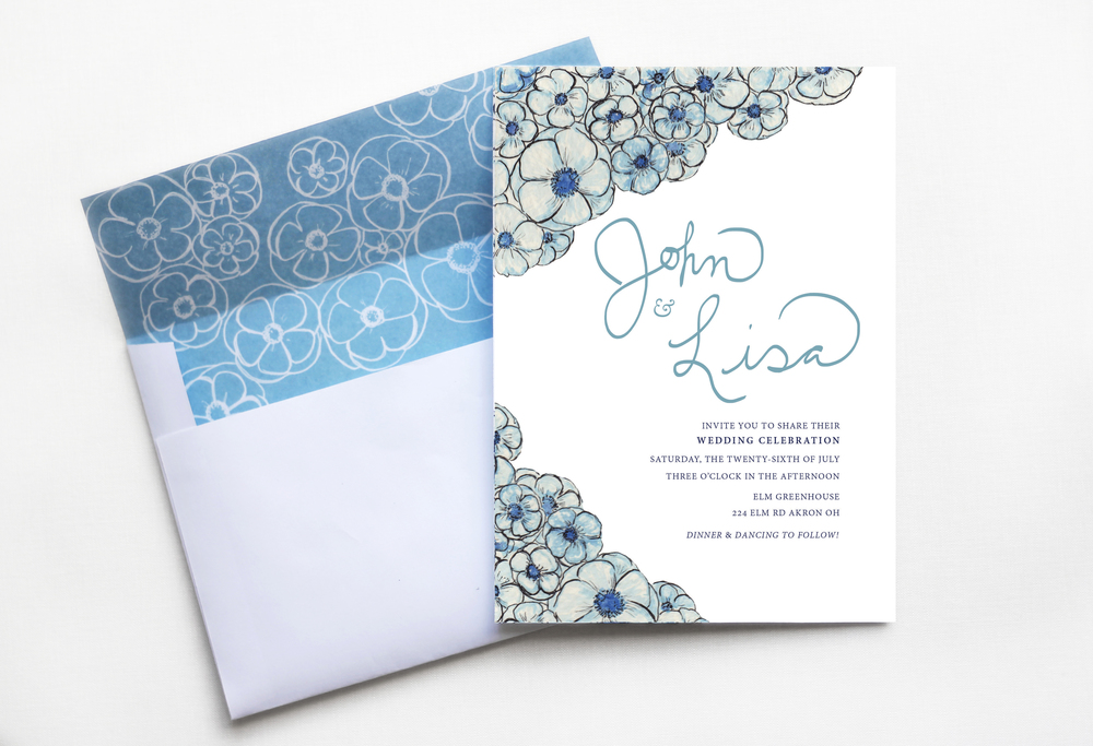 Blue poppy wedding invitation and custom matching envelope.