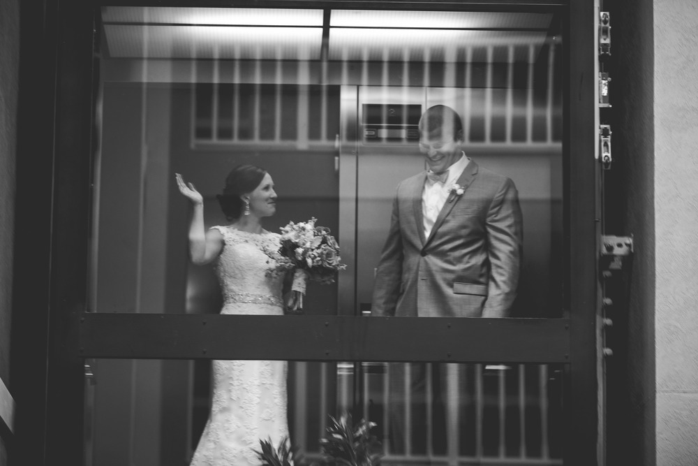 A very grand entrance in a glass elevator before all the guests.