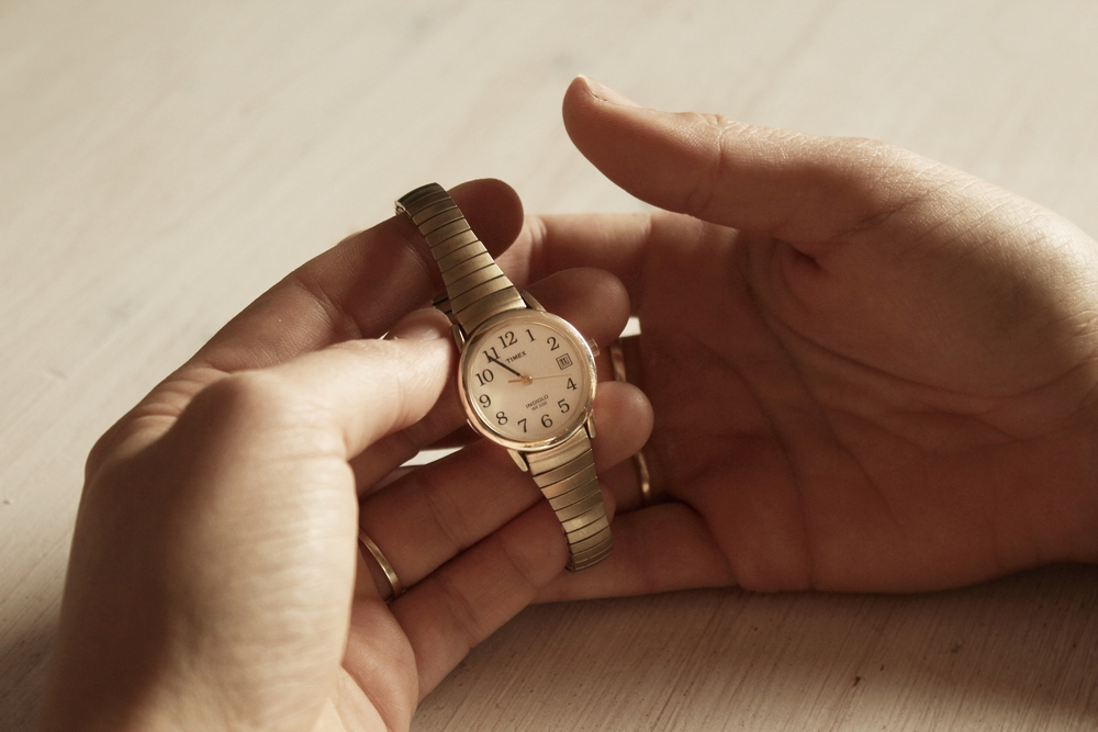 Alicia Schulmeyer's hand portrait with an object of inspiration and wonderful memories, a watch that was gifted to her by her great-grandmother.