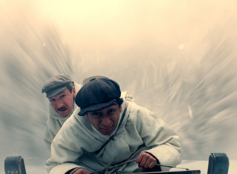 M. Gustav (Ralph Fiennes) and Zero (Tony Revolori) in pursuit from a scene in Wes Anderson's  The Grand Budapest Hotel.