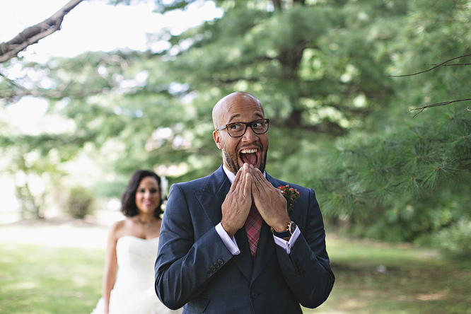 Groom surprised at beautiful bride