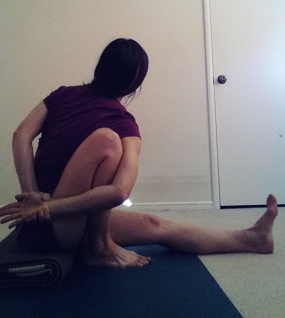 Marichyasana I twist with bind back.jpg