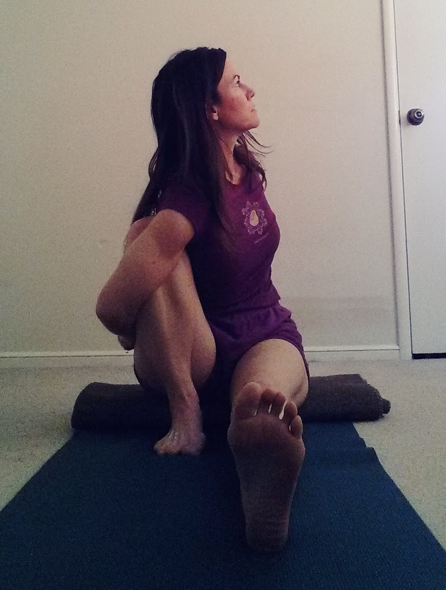Marichyasana I twist with bind up.jpg