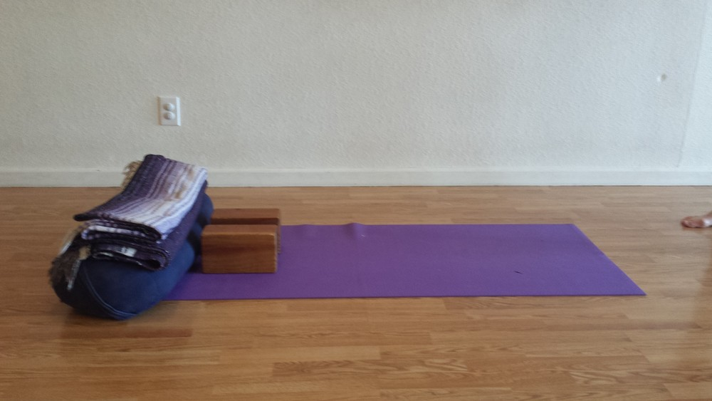 savasana with blocks for chest support.jpg