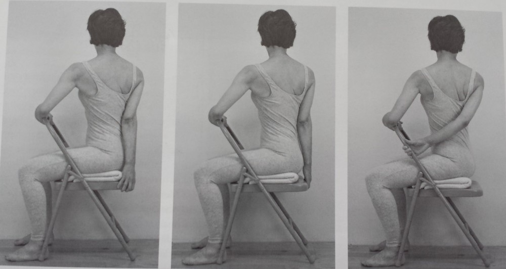 Chair Bharadvajasana holding chair.jpg