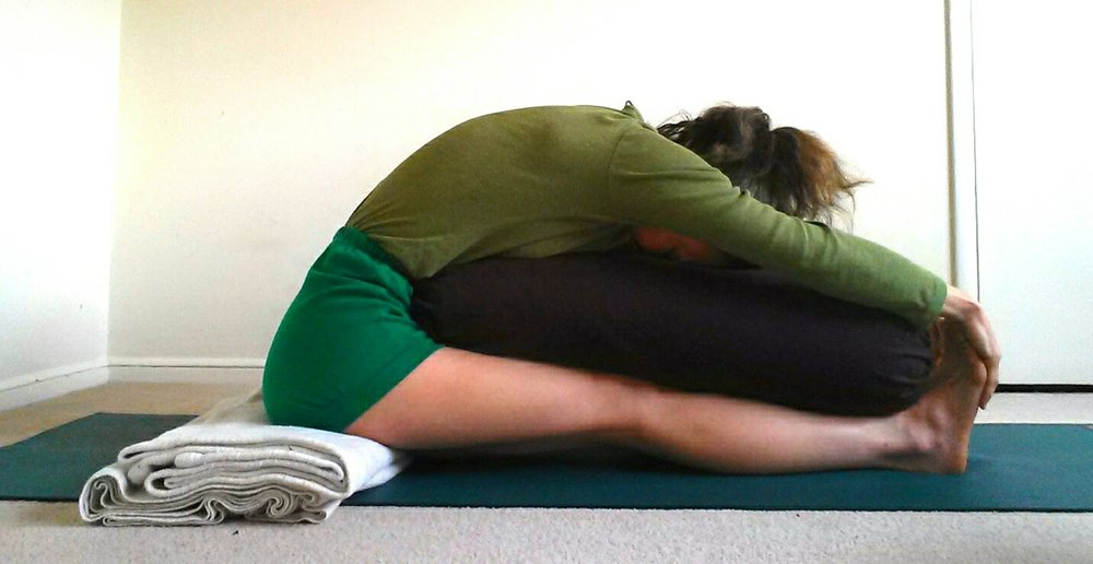 paschimottanasana with support.jpg