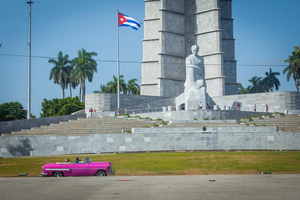 Classic American steel cruises past revolution square in Havana. 70mm f/11.0 1/500sec