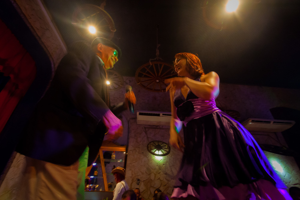 Dancers get the eager crowd in the mood at a Havana nightclub. 17mm f/4.0 1/30sec