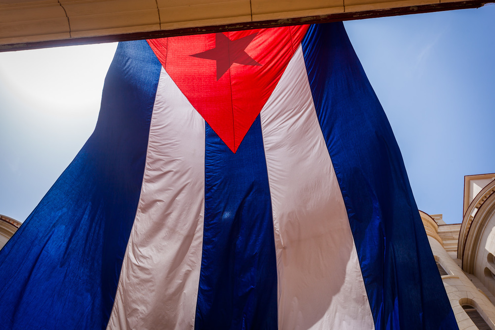 A giant Cuban flag hangs outside the Museum of the Revolution. 33mm f/8.0 1/250sec