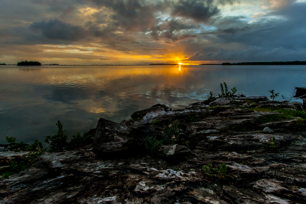 The calm after the storm. A torrential rain storm had pounded us in the skiffs on the way back to the lodge after fishing and as it past, it left a short window to snap a few sunset shots. 17mm f/22 1/60sec