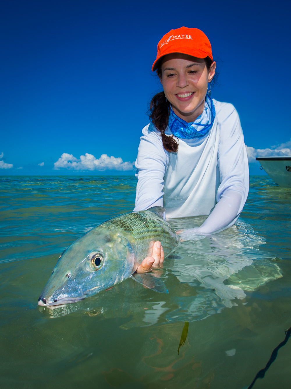 The lovely Chrysta lands large bonefish at Deep Water Cay. 19mm f/13 1/200sec