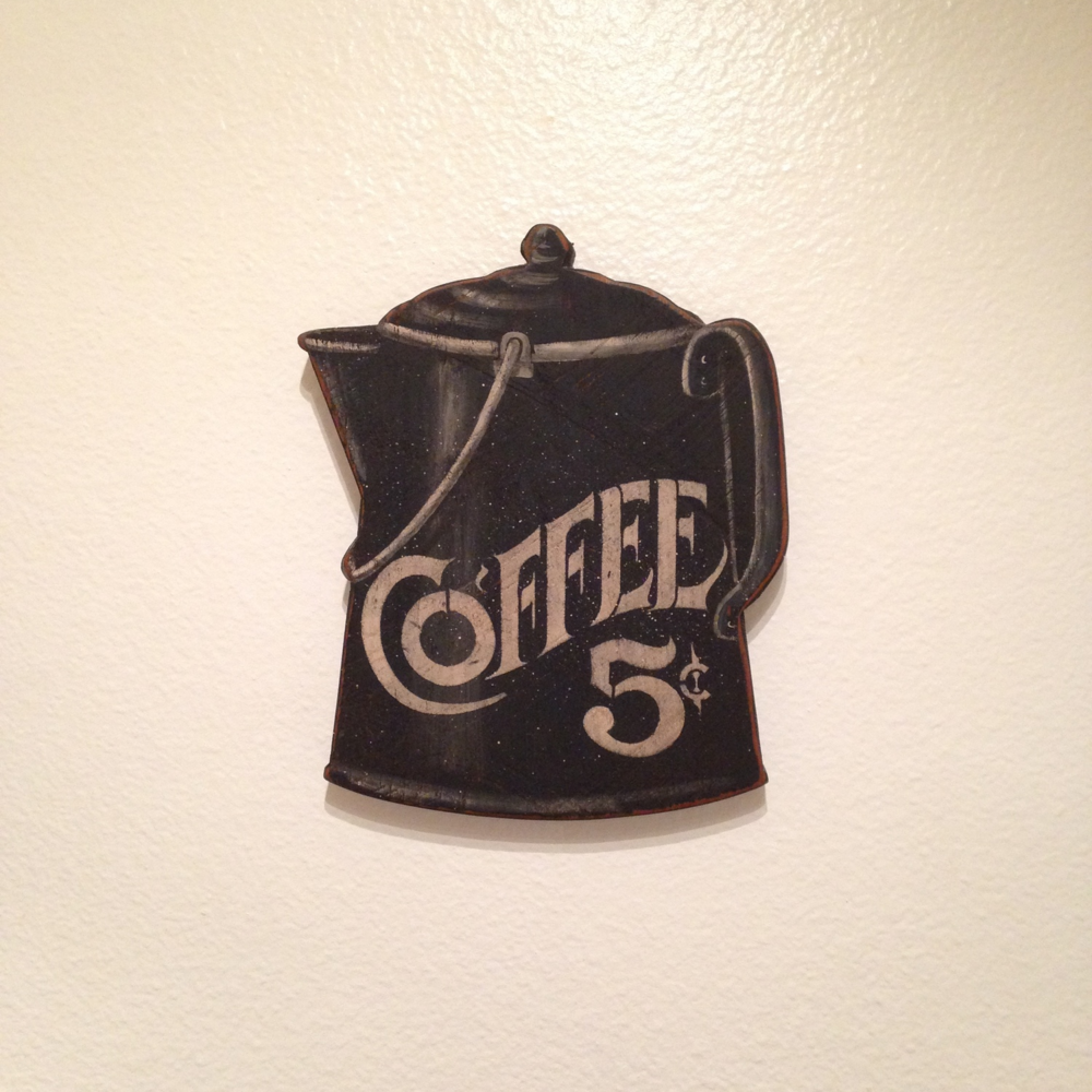 I put up our first piece of wall décor in our kitchen! It's an awesome wood piece that I bought from the Rose Bowl Flea Market in Pasedena last month.