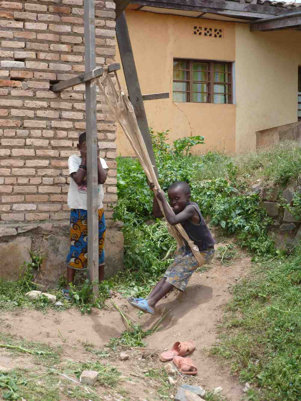 Children took advantage of materials at a construction site to invent their own swing.
