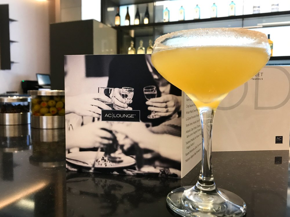Signature street car includes spiced rum and cointreau, fresh lemon, simple syrup, shaken with a quarter of orange, and a cinnamon sugar rim
