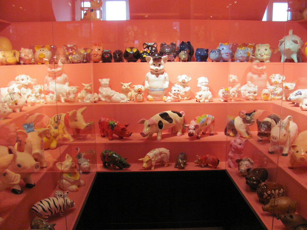 Rooms and rooms full of pigs of every size, shape, and color.