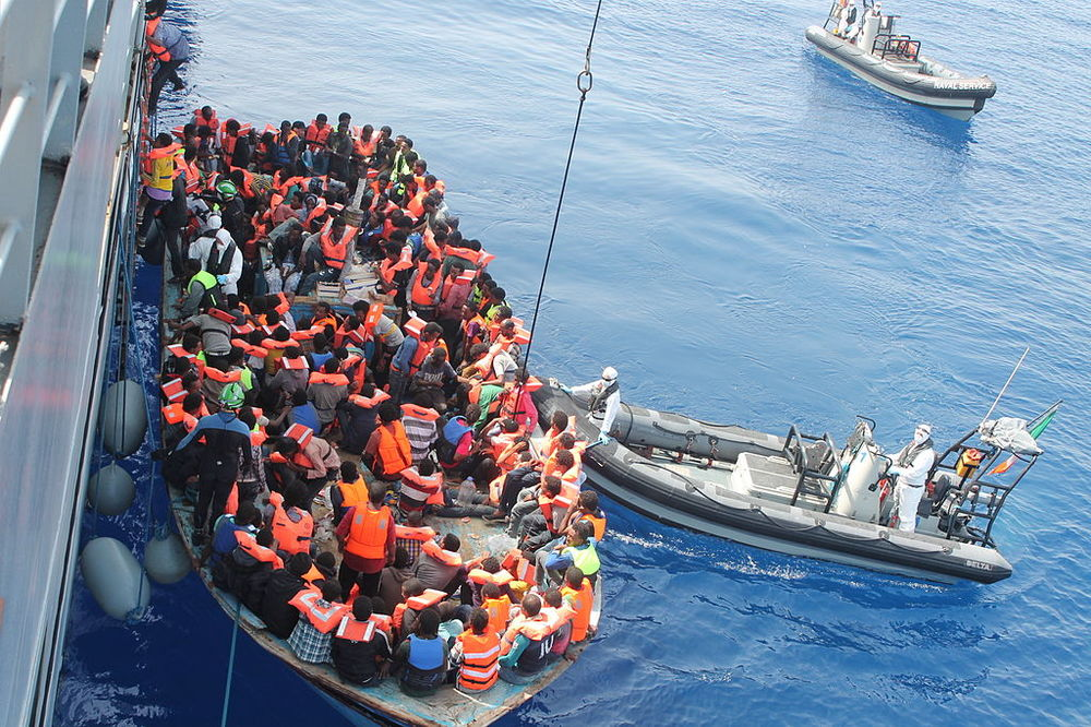 asylum seekers on a boat in the Mediterranean Sea are rescued (Wikimedia/Irish defence forces)