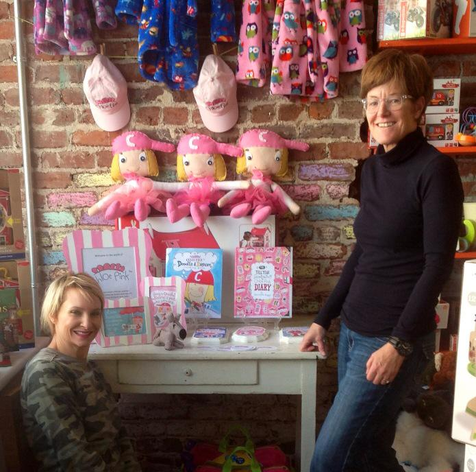 Shown left to right, Jessica Soler, owner Salon Red Kids and Sharna Fulton, creator of Chloe Pink (TM) with the Chloe Pink Collection at Decatur location.