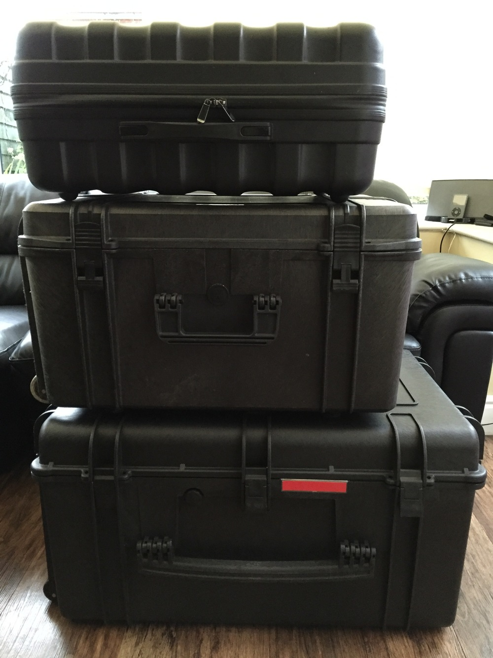 Side View: DJI Inspire 1 Case (top), Multi Rotor Axessories Inspire 1 Travel Mode Case (middle) and Panzer Cases Aurora Inspire 1 Flight and Travel Mode Case (bottom).
