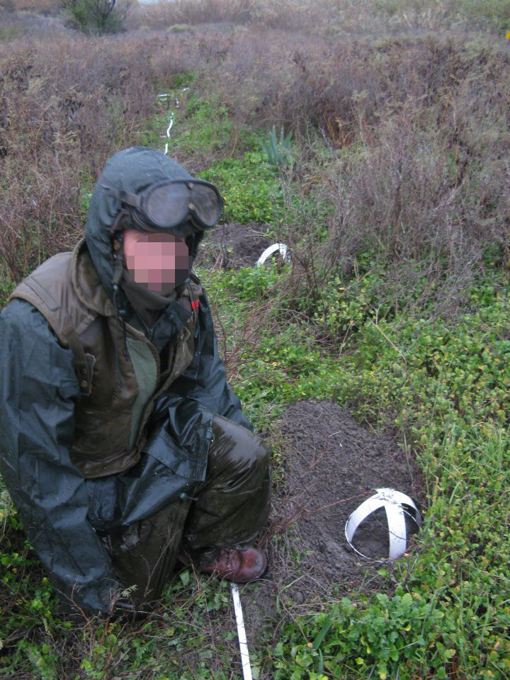One of my team mates  during EOD course. Note the rain gear.