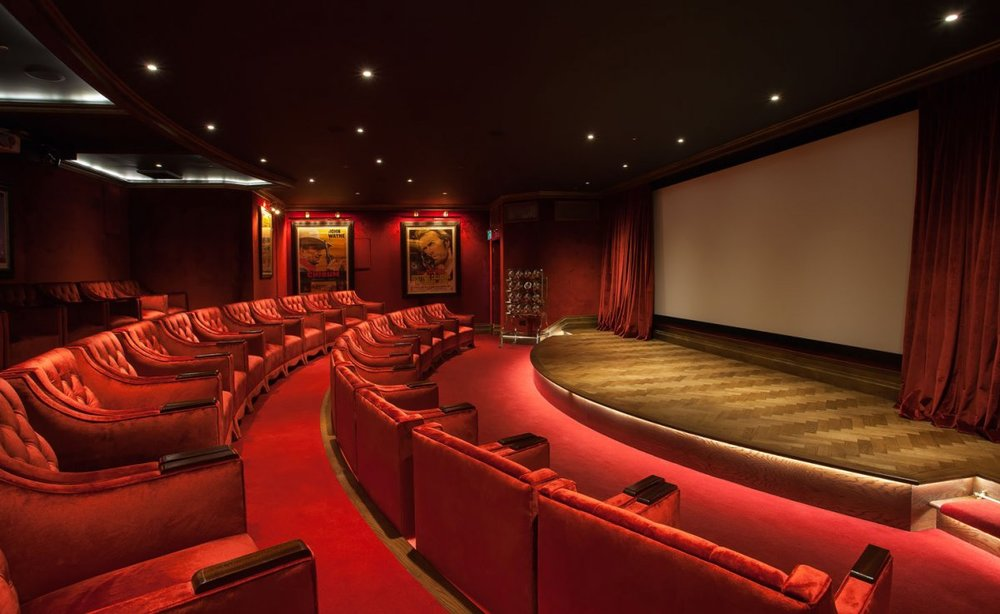 There's a cinema room that's been designed with the comfort of a traditional movie theater. Red velvet chairs allow for plenty of leg room for guests to enjoy while they watch a selection of daily movies
