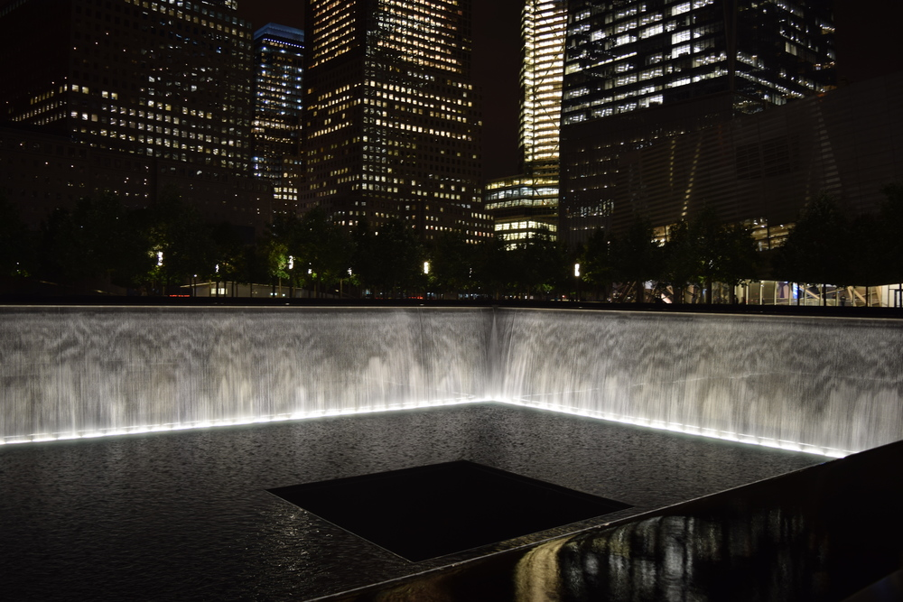 The 9/11 Memorial. Names are listed around the sides of the fountain, which is built on the space left by one of the towers.