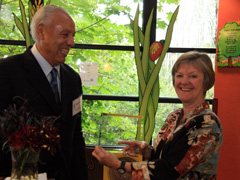 "Dr. Sherris receiving the Odessa Brown Children's Clinic's 2010 ""Spirit of Caring"" award from Lenny Wilkens, trustee of Seattle Children's Hospital Foundation"