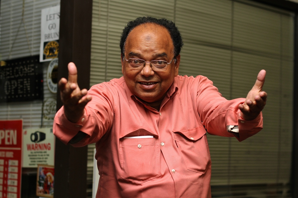 "I was walking along the Fresh Pond strip mall, when I saw a man, about mid-forties with his child. After explaining what i was doing, he got his friend and they took a picture together. Then they got their friend. This is their friend. He is all the way from Bangladesh. We had to speak through one of his friends who translated for me.  ""What is the biggest problem in the world right now?"" ""Food problem. Food problem."" ""Okay. So not enough food or not enough good quality food?"" ""He's saying that there's a shortance of the food that people need to live in the world. I mean, not only in America, he's not mentioning America, it's a world problem."""