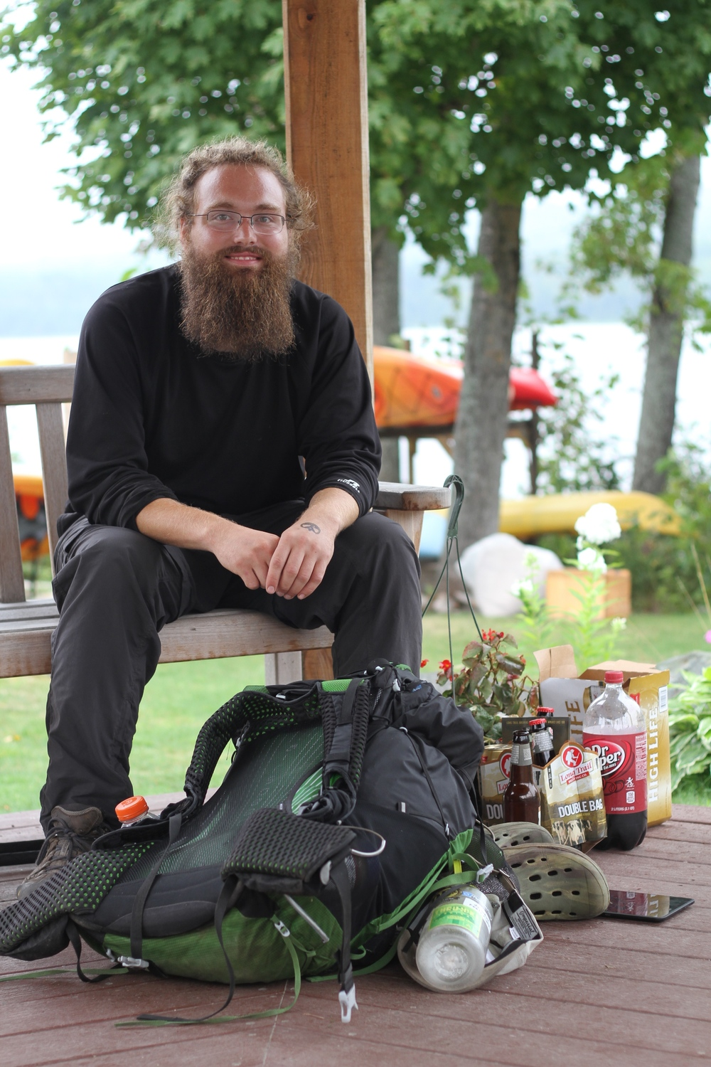 "This is Dan. He is an Appalachian Trail thru-hiker that I met in Rangeley, Maine. I was staying with my friend in Rangeley when he said we told me we might see some thru hikers. Dan blew me away. His story of hiking the AT was intriguing, beautiful and inspiring. I plan to hike the trail someday because of him. He compared his experience to a day job. Not every day did he wake up and want to hike. Some days he would wake up and not want to take another step. Even if he didn't want to hike (or go to work) he still did it each day. Starting in Georgia in April, he was nearing the end of his trip. He was given the trail name ""Grizzly"" by other hikers because of his similar appearance to Grizzly Adams."