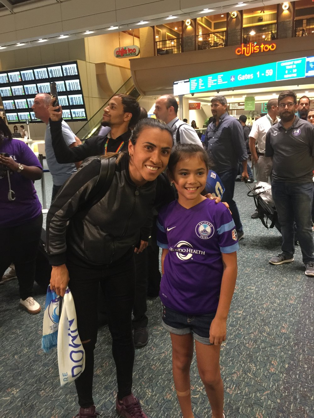 A young member of The Crown gave Marta her first Orlando supporters' scarf when she arrived on Thursday night.