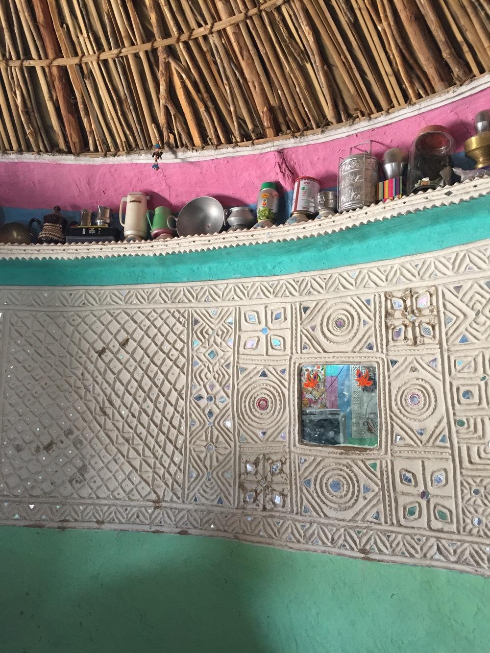 Decorative mudwork inside a home in Hodka