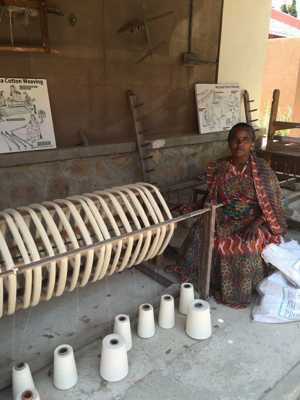 Spinning yarn at Khamir
