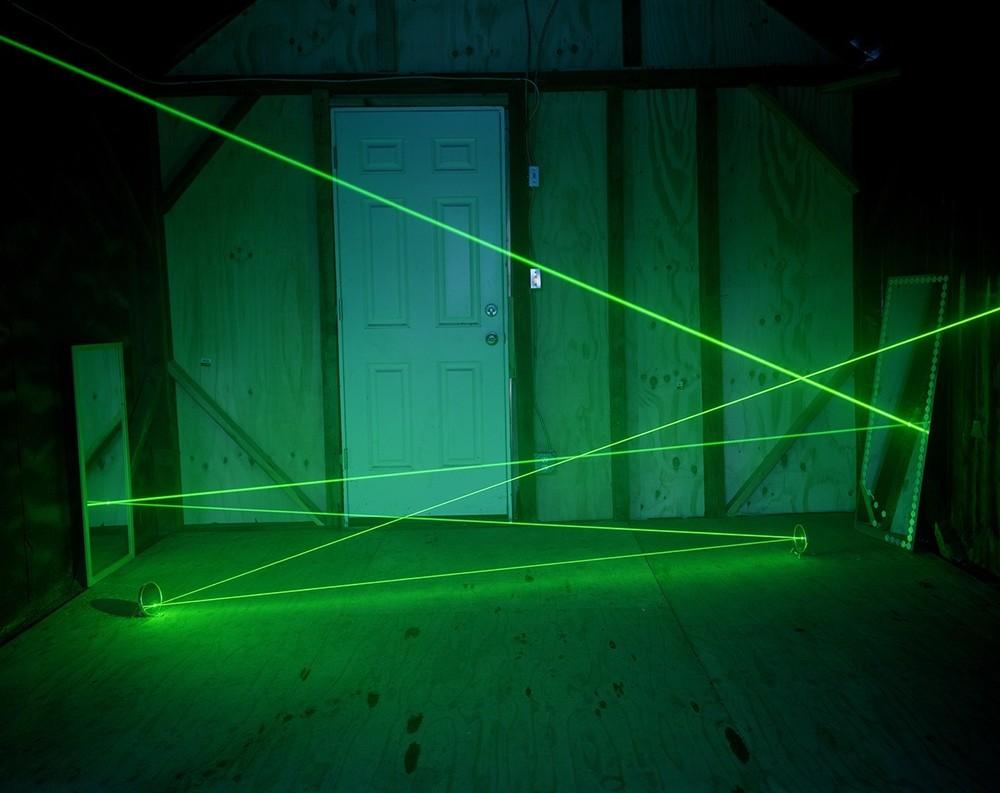 A Laser Beam in a Cabin, 2016. © Adam Ekberg