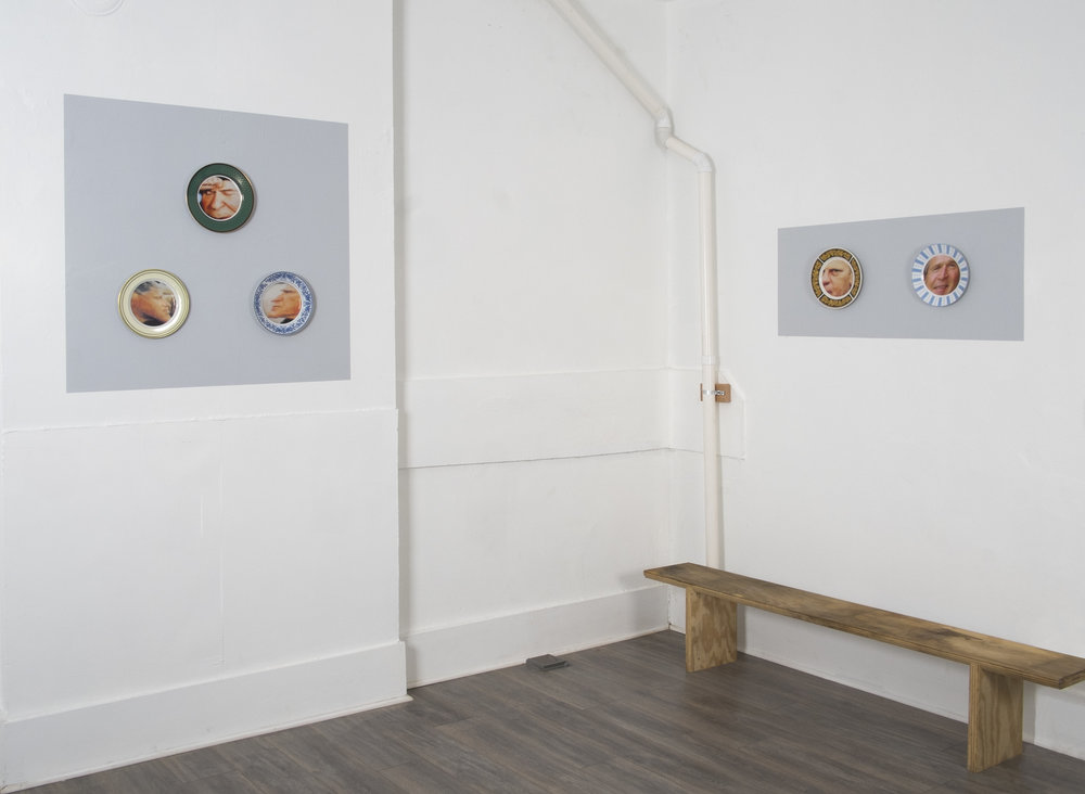 State Dinner Plates-installation view:  Left Panel,  Clockwise from Top: Bean Gilsdorf. Ronald Reagan, 2018; ceramic plate; 10.25 inch diameter. George H. W. Bush, 2018; ceramic plate; 9.75 inch diameter. Bill Clinton, 2018; ceramic plate; 10 inch diameter.  Right Pane l, Left: Gerald Ford, 2018; ceramic plate; 10.5 inch diameter. Right Panel, Right: George W. Bush, 2018; ceramic plate; 10 inch diameter.