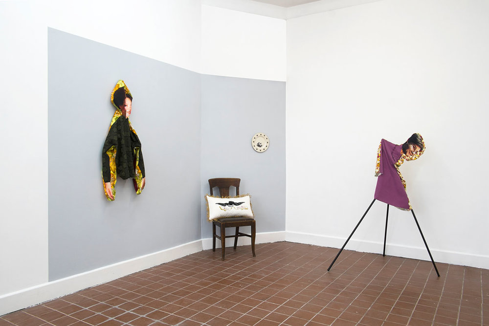 Left to Right: RC, 2018; polyester, cotton; 48 x 18 x 8 in. Bean Gilsdorf. Bless This Mess, 2018; pillow with hand embroidery; polyester, cotton, fringe, poly stuffing; 22 x 12 x 6 in. Republic, 2018; ceramic plate, 10.75 inch diameter. LB, 2018; polyester, rayon, wood, paint; approx. 60 x 44 x 29 in.