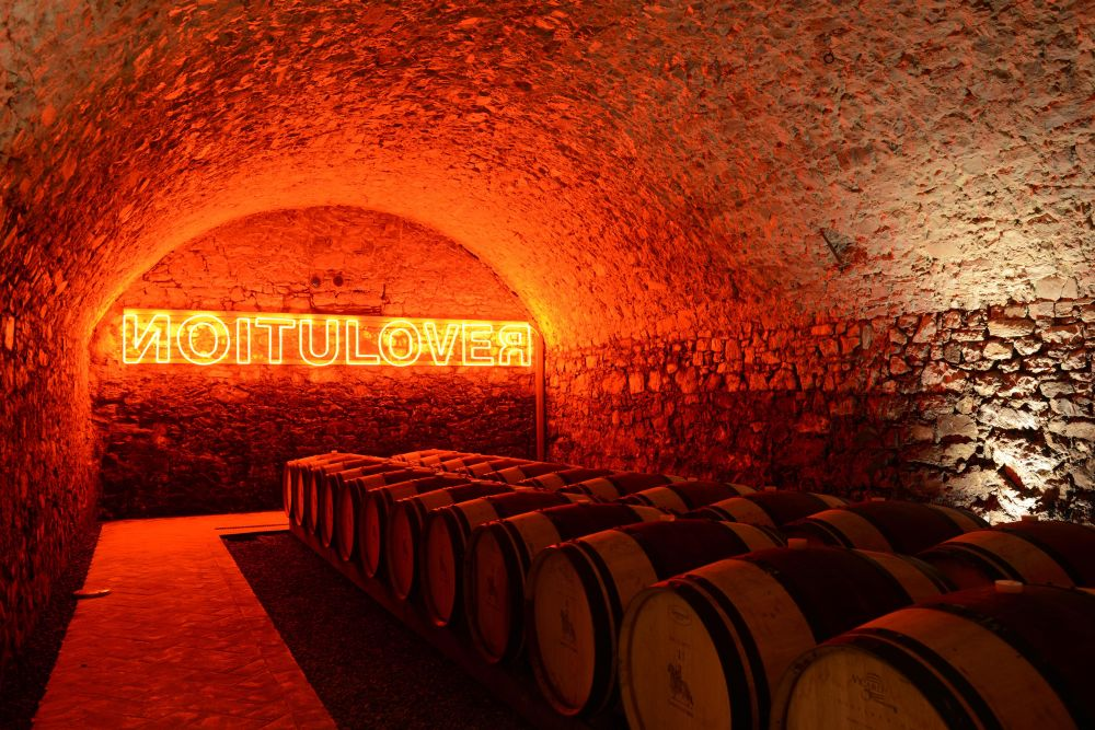Ama's barrel room, with Kendell Geers's art installation 'Revolution/Love' (2003)