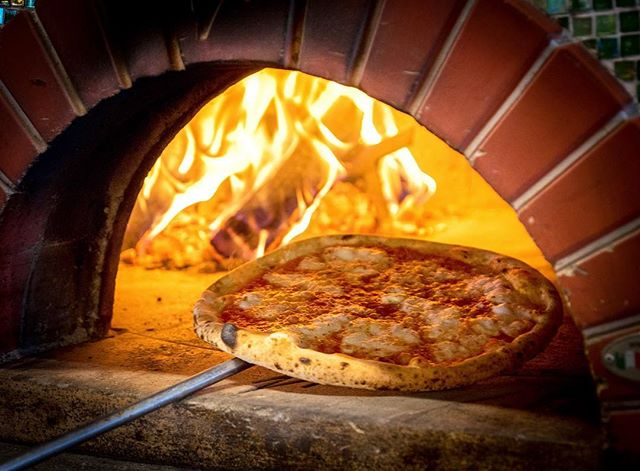 Warming up by the fire. Wood-fired pizza from Vero Italian.