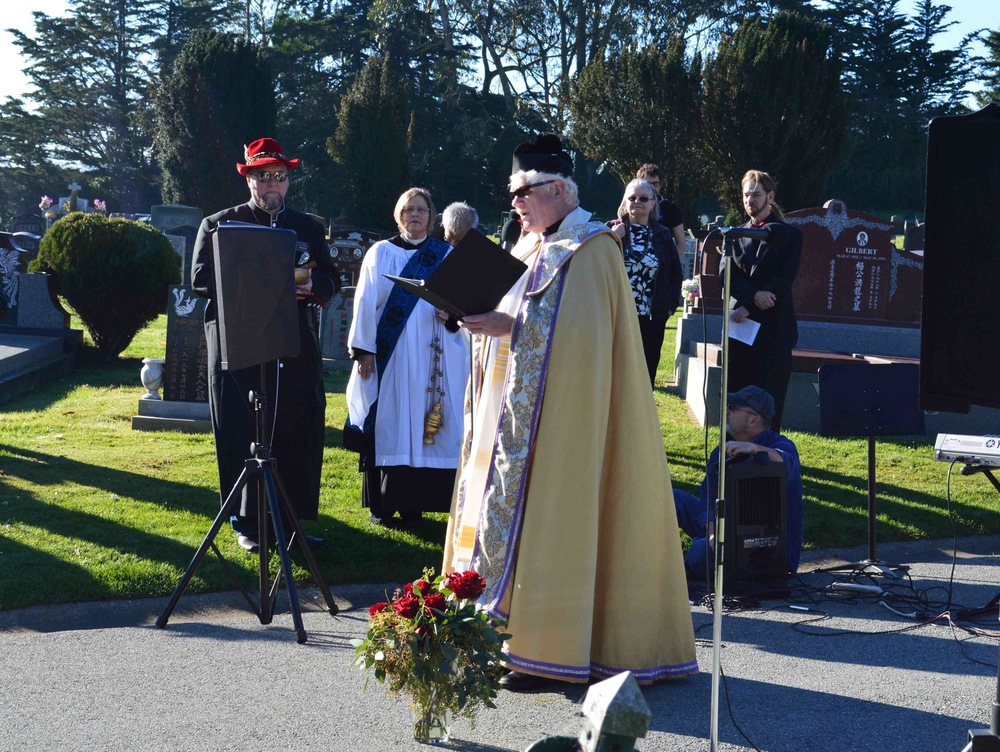 On Sunday 15 February 2015, the Rev. Lyle Beckman of San Francisco Night Ministry offers keynote remarks at the Imperial  Court's 40th anniversary pilgrimage to the graves  of Emperor Norton and Jos é  Sarria, the Widow Norton.  Photo: John Blackburn.