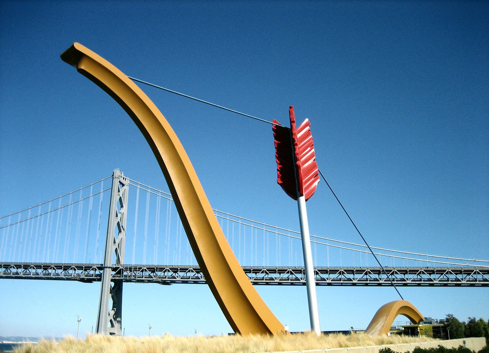 The Emperor Norton Bridge   a.k.a. the Bay Bridge, in San Francisco, as seen from  Rincon Park . In the foreground:  Cupid's Span  (2002), by Claes Oldenburg and Coosje van Bruggen. Photograph © 2007 Σταύρος.