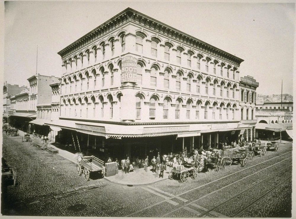 The Niantic Building (1872), at the northwest corner of Sansome (in the foreground) and Clay Streets, San Francisco.  The building adjacent and to north, on Sansome, is 511 Sansome, at the southwest corner of Sansome and Merchant. Depending on when this photo was taken, Cuddy & Hughes and/or the  Pacific Appeal  newspaper may no longer have been operating out of the building. Photograph in the collection of the Bancroft Library at UC Berkeley. Source:  Calisphere .