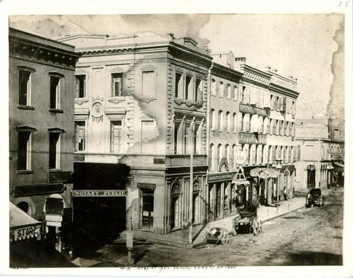 Northwest corner of Commercial and Montgomery Streets, San Francisco, 1865.  Montgomery runs north-south in the foreground. Emperor Norton's palace, at the Eureka Lodgings, was a half-block west along Commercial. Photograph uncredited. Source: San Francisco Public Library.