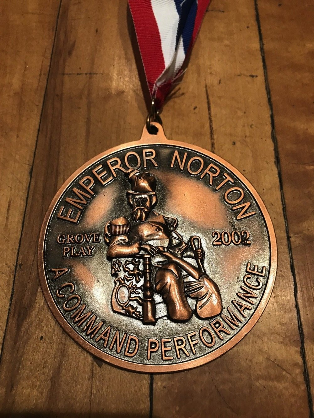 Medal, Bohemian Club, 2002.  The Bohemian Club presented this medal, as a gift of thanks, to each member of the cast of  Emperor Norton: A Command Performance , the 2002 Grove Play, performed on 26 July 2002. An item mentioning the medal appeared in the August 2002 newsletter of the Redwood Empire Chinese Association,  here . Source:  eBay .