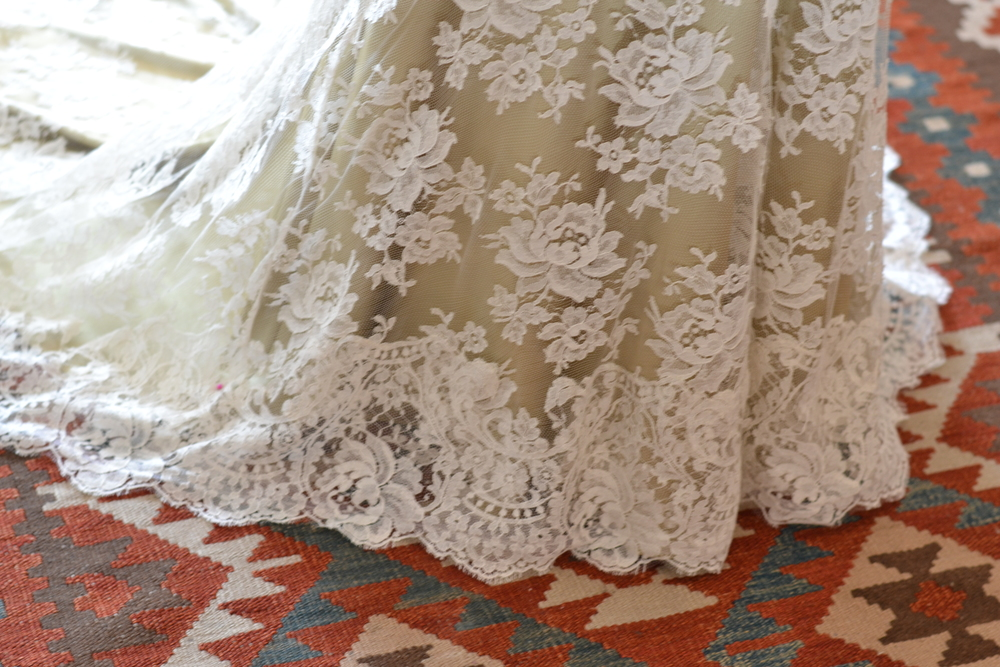 Hand applied lace edge on skirt