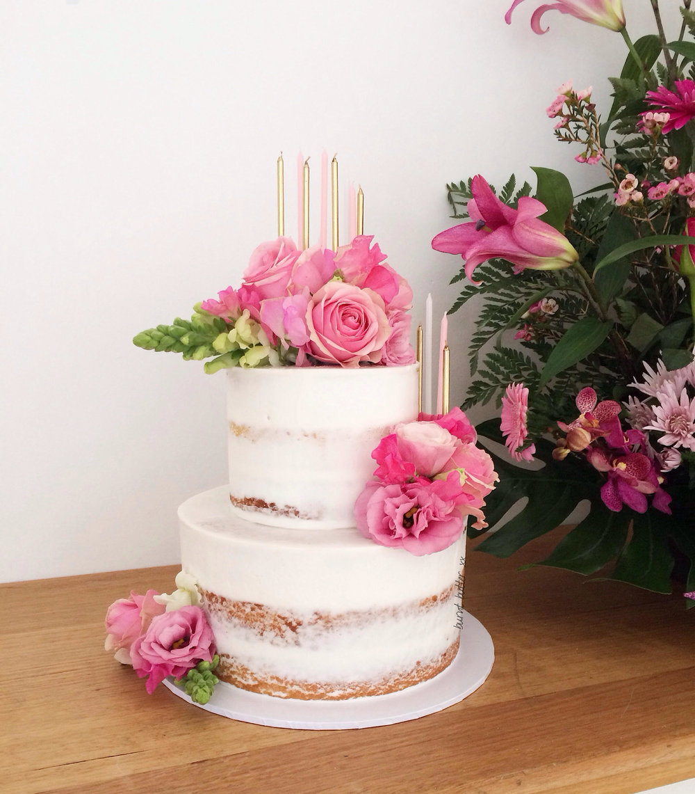 Two Tiered Semi Naked Cake With Fresh Flowers Burnt