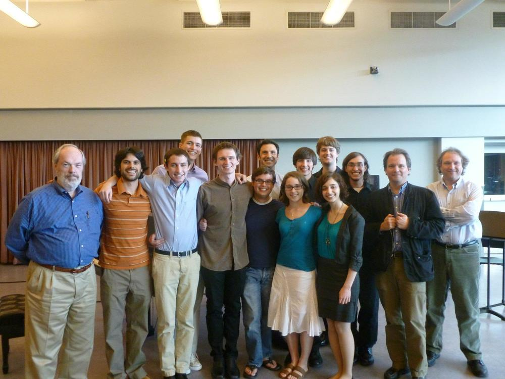 Photograph of my West Chester University Composer colleagues and me in May 2012. Colleagues include Hassan Estakhrian, Jim Doyle, Peter Christian, Andy Norman, Natalie Dietterich, Michelle Saddic, Alex Marthaler, Kyle Benson, and Danton Arlotto. Faculty in photograph includes Dr. Larry Nelson, Dr. Robert Maggio, Dr. Van Stiefel, and Dr. Mark Rimple.