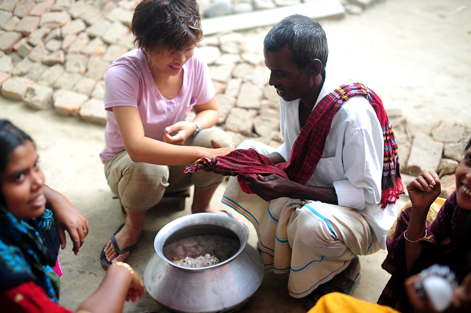 Bernice being taken care of in a Bagladeshi village. Her host discovered her working with chilli powder while making briyani and was afraid that she had hurt herself.