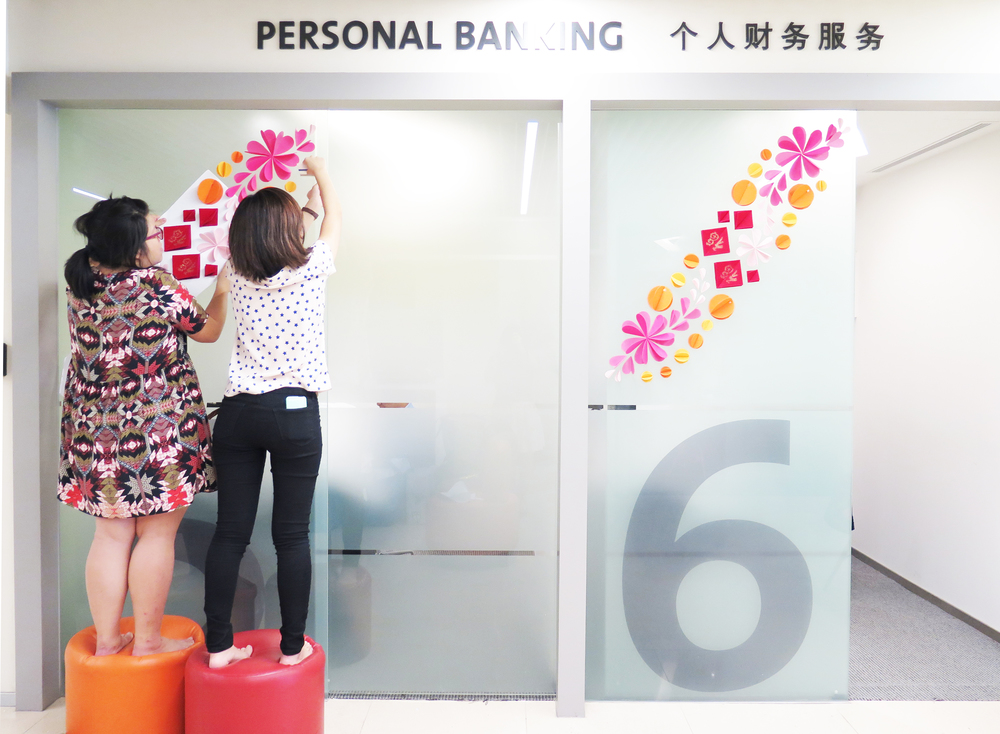 In Merry Motion setting up Chinese New Year embellishments at OCBC flagship branches in 2014