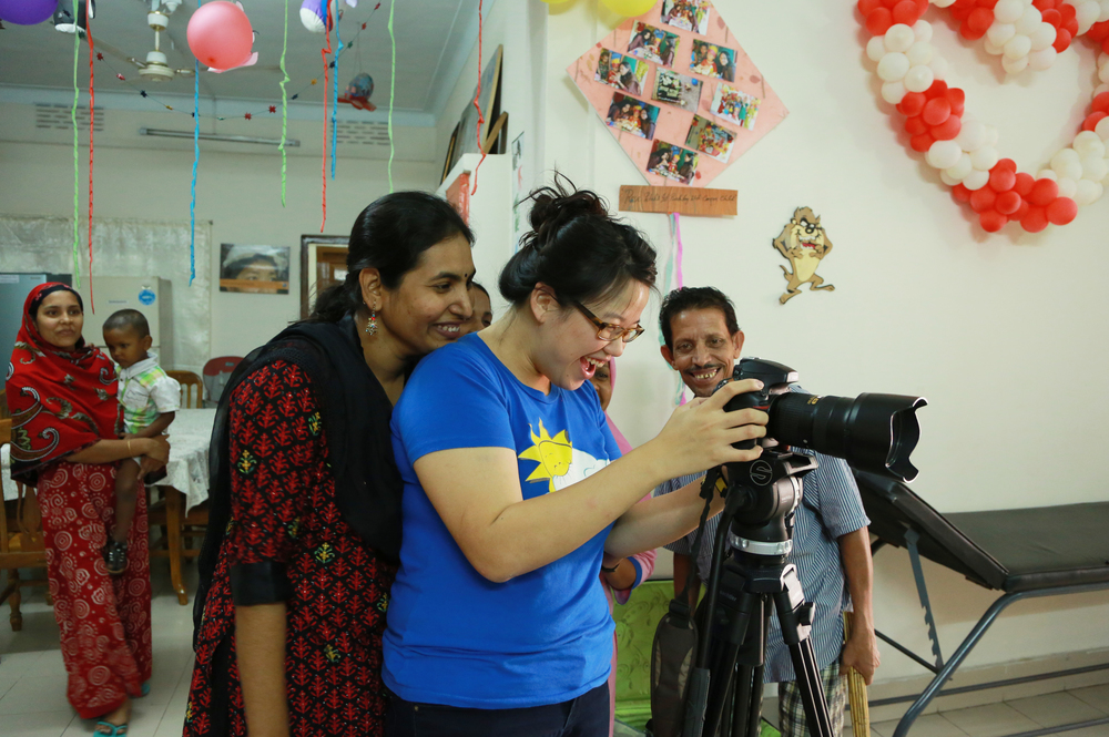 Photographing the team at the ASHIC Palliative Care Centre for children in Dhaka, Bangladesh while working on After Cicely